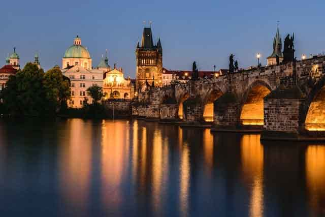 Charles Bridge after sunset Prague Czechia top 10 cheap european destinations on a budget ranked vdiscovery arvinovoyage