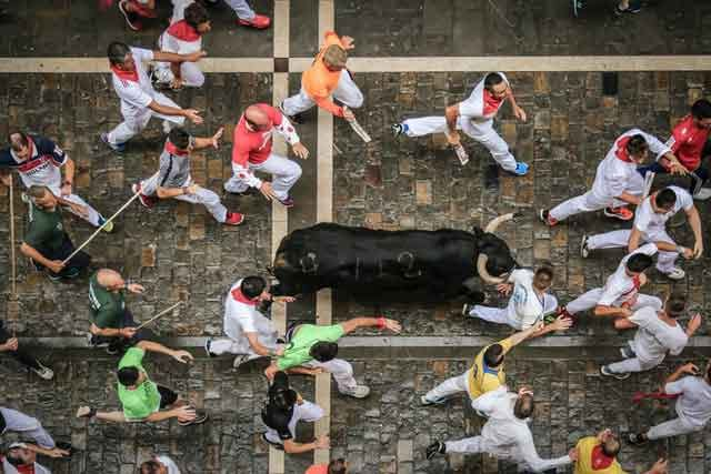 Running of the Bulls Pamplona tired of ordinary travel this is the most dangerous tourist place in the world